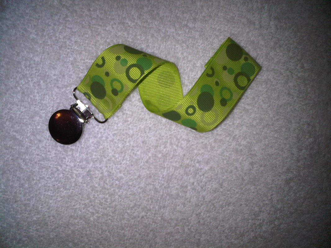 9498508 orig This wonderful pacifier clip is not only functional but stylish!